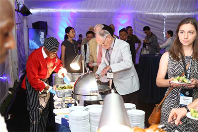 Attendees grab plates of food and settle in for the 2017 GGCS Opening Reception