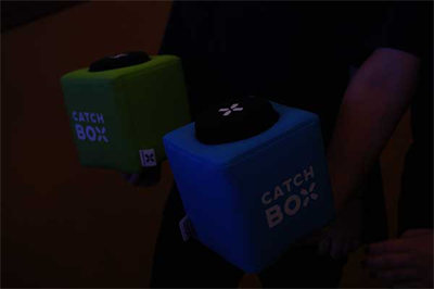 Catch Boxes within internal microphones allowed sitting attendees to participate in discussion with panelists throughout the event